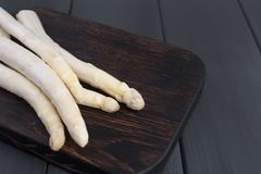 White asparagus, on a wooden board on a table. Summer vegetables. Healthy food. Free space for text. Copy space. stock photo