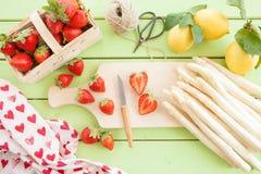 White aspargus and fresh strawberries Stock Image
