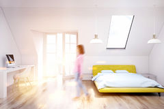 White attic bedroom, wooden floor, yellow, girl Royalty Free Stock Photos