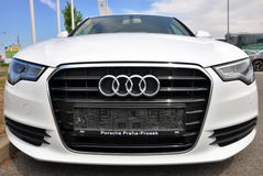 White Audi A6. PRAGUE, THE CZECH REPUBLIC, 02.08.2015 - Brand new white Audi A6 parks in front of Car Store Audi Stock Photo