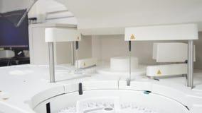 White automate chemistry analyzer. Close up science laboratory test tubes laboratory equipment.White automate chemistry analyzer stock video