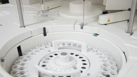 White automate chemistry analyzer. Close up science laboratory test tubes laboratory equipment.White automate chemistry analyzer stock video footage