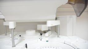 White automate chemistry analyzer. Close up science laboratory test tubes laboratory equipment.White automate chemistry analyzer stock footage