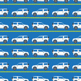 White automobiles. Seamless pattern with white automobiles on a blue background Royalty Free Stock Photo