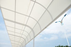 White awning. Over bright sunny blue sky stock photos