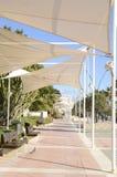 White awnings at the promenade. Of Estepona, Malaga, Andalusia, Spain Stock Image