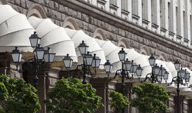 White Awnings Street Lanterns. Many white awnings and black old style street lamps Stock Image