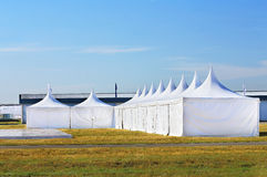 White awnings. White tents at the exhibition camp appointed as pavilions Royalty Free Stock Image