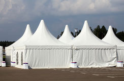 White awnings. White tents at the exhibition camp appointed as pavilions Stock Photography