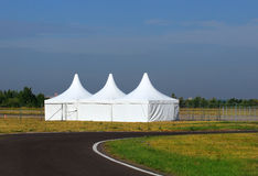 White awnings. Three white tents at the exhibition camp Royalty Free Stock Image