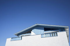 White & baby blue oceanside craftsman style bungalow on the West Coast in Ventura, California. A testament to easy beach living royalty free stock images
