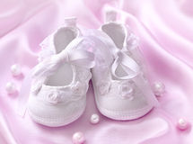 White baby booties Royalty Free Stock Image
