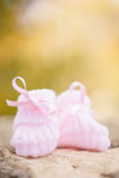 White Baby booties on a green natural background. In autumn Royalty Free Stock Photography