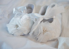 White  baby christening shoes Royalty Free Stock Images