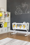 White baby cradle. With yellow bowknots in blackboard room Stock Photo