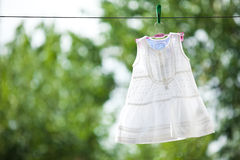 White baby dress outdoor Royalty Free Stock Images