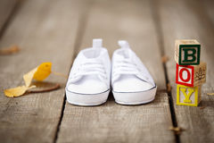 White baby`s bootees Stock Photography