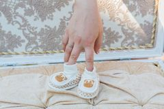 White baby's shoes. Royalty Free Stock Images