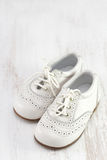 White baby shoes Stock Photos