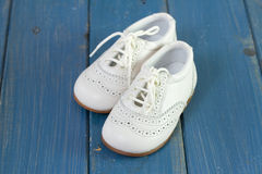 White baby shoes Royalty Free Stock Image