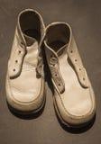 White baby shoes Stock Photos