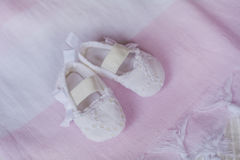 White baby shoes stock photography