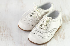 White baby shoes on white background Royalty Free Stock Images