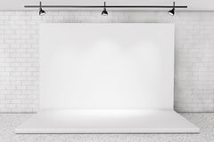 White Backdrop Stage in Room with Brick Wall Royalty Free Stock Image