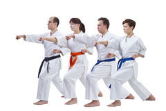 On a white background the athletes with different colors of belts are beating punch arm. Athletes with different colors of belts are beating punch arm Stock Images