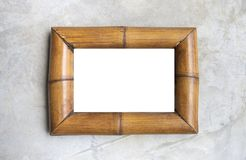 White background on bamboo wood picture frame. On grey cement wall stock photos
