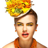 White background and beautiful fashion girl blink at camera. With rowanberry accessories royalty free stock images