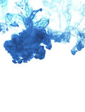 White background with blue ink in water Royalty Free Stock Image