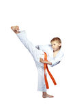 On a white background boy in karategi beat kick Yoko-geri Stock Photography