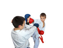 On a white background boys trained karate techniques. Boys trained karate techniques on a white background Royalty Free Stock Photos