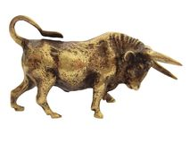 The bronze figurine of a bull on a white background. royalty free stock photo