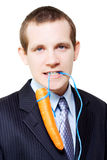 White background business person dangling a carrot Royalty Free Stock Image