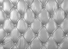 Decor Chesterfield from a white leather stock photos