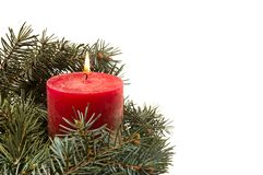 White background with and Christmas tree branches and burning candle stock photo