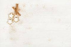 White background with cinnamon stars Royalty Free Stock Photography