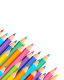 White background with colored pencils. In corner royalty free illustration