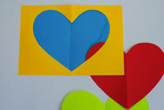 On a white background a colorful sheets with a heart. Royalty Free Stock Image
