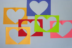 On a white background a colorful sheets with a heart. Stock Photography