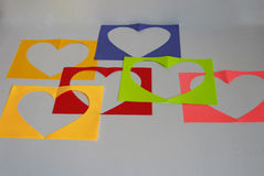 On a white background a colorful sheets with a heart. Stock Image