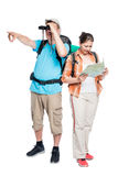 On a white background couple of travelers with backpacks. Isolated Royalty Free Stock Image