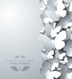 White background with cutout butterflies, vertical composition Royalty Free Stock Photos