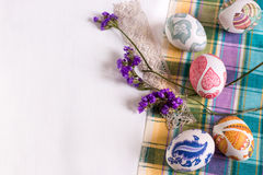 White background with Easter eggs. Easter eggs and flowers on a checkered cloth Stock Photography
