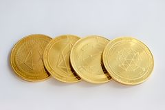 Crypto currency digital coins - qtum and eos. On a white background are the front and back side of gold coins of a digital crypto currencies - qtum and eos royalty free stock photos