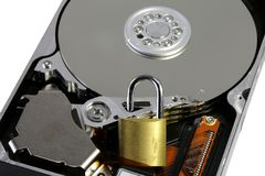 White background and hard disk of a computer with the padlock to. White background and hard disk drive of a computer with the closed padlock to make the data Stock Image
