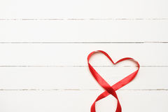 White background with heart shaped ribbon Stock Image