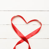 White background with heart shaped ribbon Stock Images